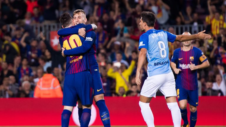 BARCELONA, SPAIN - OCTOBER 21:  Gerard Deulofeu of FC Barcelona celebrates with his teammate Lionel Messi after scoring the opening goal during the La Liga