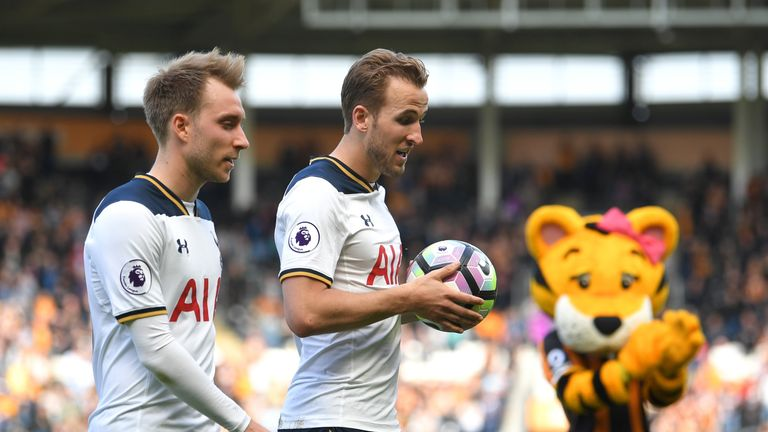 HULL, ENGLAND - MAY 21: Harry Kane of Tottenham Hotspur walks off the pitch alongside Christian Eriksen after scoring a hat-trick and winning the Premier L