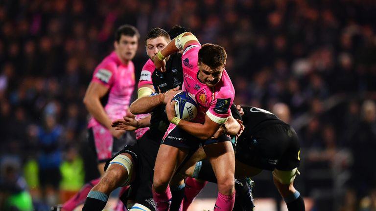EXETER, ENGLAND - OCTOBER 14:  Henry Slade of Exeter Chiefs is tackled by Finn Russell of Glasgow Warriors during the European Rugby Champions Cup Pool 3 m