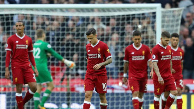 LONDON, ENGLAND - OCTOBER 22: Philippe Coutinho of Liverpool and his Liverpool team mates are dejected after Tottenham Hotspur fourth goal during the Premi