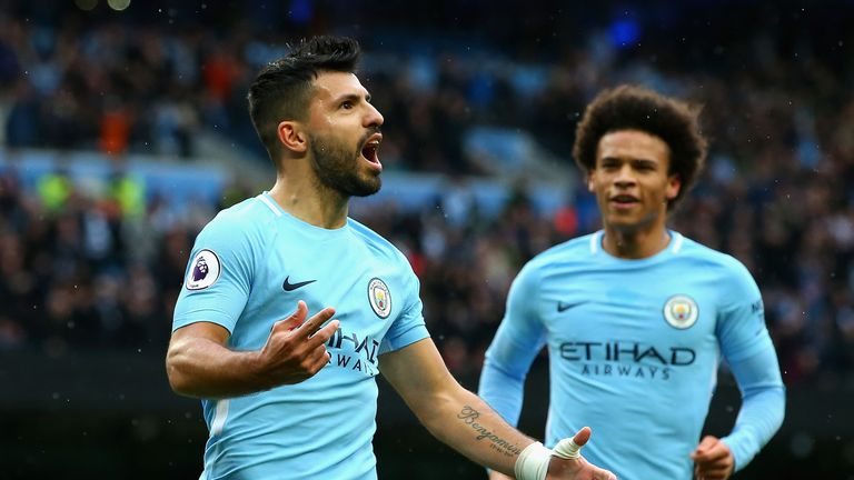 MANCHESTER, ENGLAND - OCTOBER 21:  Sergio Aguero of Manchester City celebrates as he scores their first goal from the penalty spot with Leroy Sane of Manch