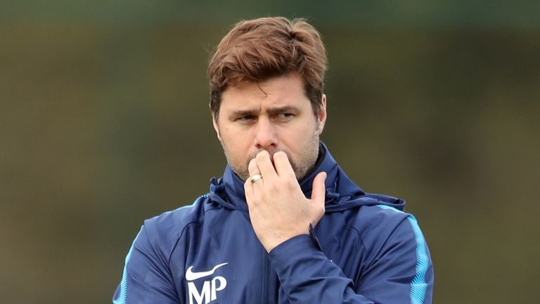 Mauricio Pochettino appears deep in thought during a training session at Tottenham's Enfield Training Centre