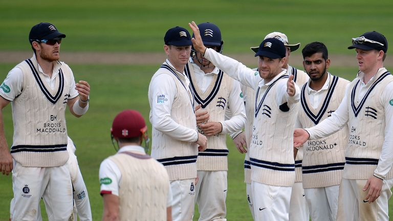 TAUNTON, ENGLAND - SEPTEMBER 25: The Middlesex team react as James Hildreth(bottom) of Somerset is given not out to a decision during Day One of the Specsa