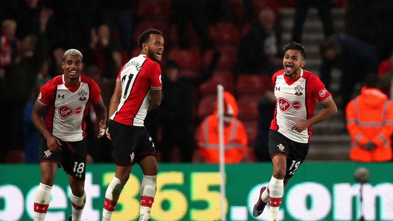 SOUTHAMPTON, ENGLAND - OCTOBER 21:  Sofiane Boufal of Southampton celebrates with teammates after scoring his sides first goal during the Premier League ma