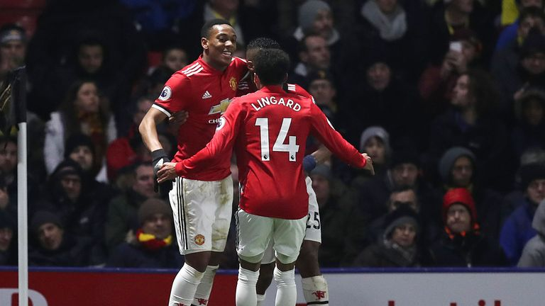 Anthony Martial celebrates with team-mates after extending Man Utd's lead at Vicarage Road