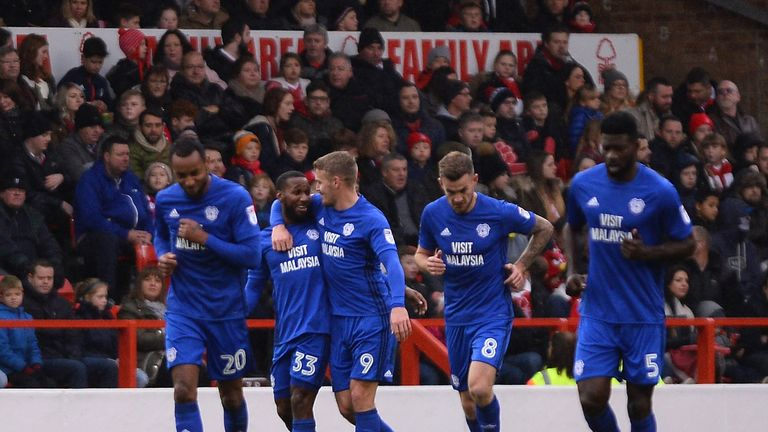 Junior Hoilett is hugged by Danny Ward of Cardiff City after he scores the first goal