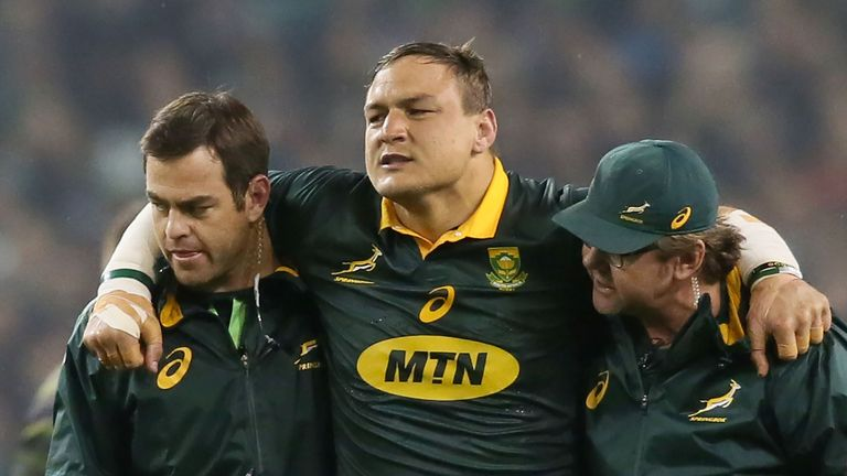 Springbok prop Coenie Oosthuizen leaves the field with an injury