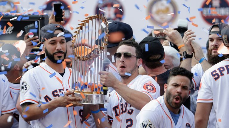 Marwin Gonzalez and Alex Bregman hold the World Series Trophy during the Houston Astros Victory Parade