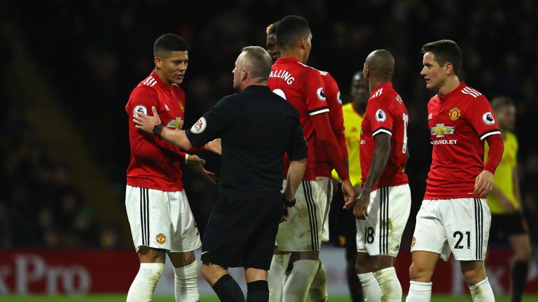 WATFORD, ENGLAND - NOVEMBER 28:  Marcos Rojo of Manchester United in discussion with referee Jonathan Moss during the Premier League match between Watford
