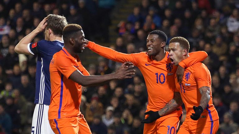 Memphis Depay (R) celebrates scoring the only goal of the game with Liverpool's Georginio Wijnaldum