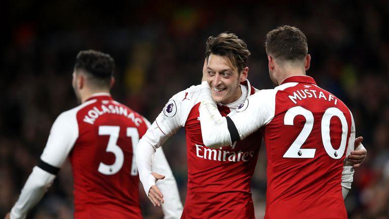 Mesut Ozil scored Arsenal's fourth goal against Huddersfield