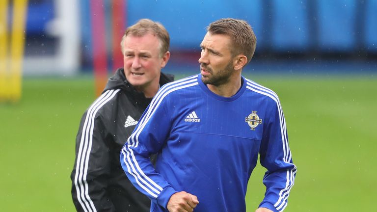Gareth McAuley feels Michael O'Neill could make the switch to club management with ease.