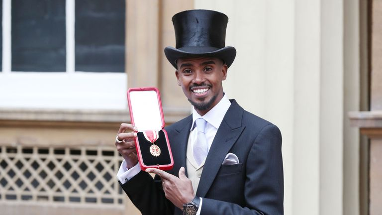 Sir Mo Farah poses with his Knighthood following the Investiture ceremony at Buckingham Palace