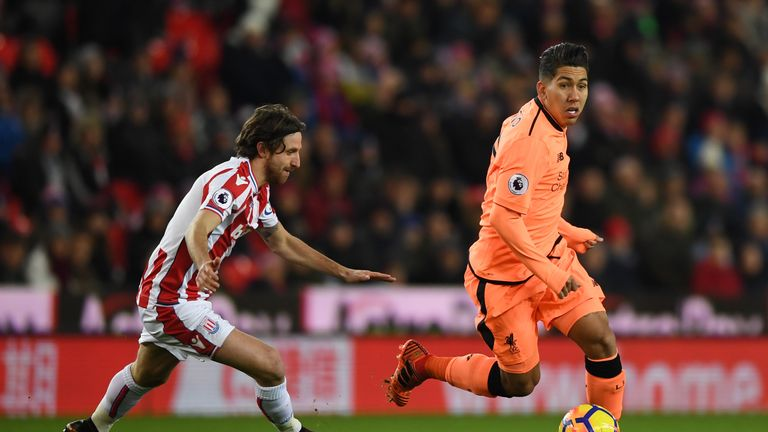 Roberto Firmino takes the ball away from Joe Allen
