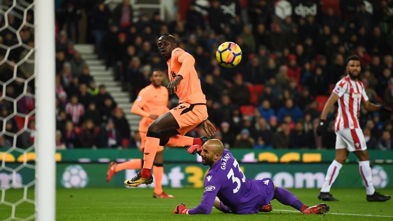Sadio Mane lifts the ball over Lee Grant to open the scoring at the bet365 Stadium