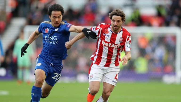 Shinji Okazaki and Joe Allen battle for possession at the Bet365 Stadium
