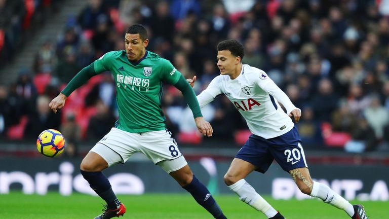 Jake Livermore is put under pressure from Dele Alli