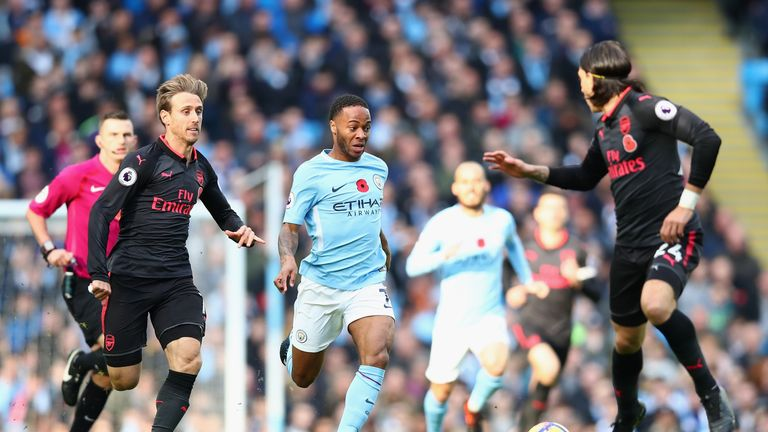 Raheem Sterling battles for possession in the first half