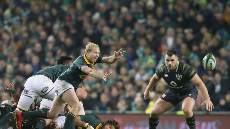 Ross Cronje passes the ball as Cian Healy watches on
