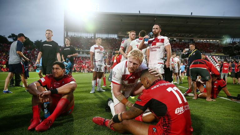 James Graham consoles Tonga forward Manu Ma'u after the final whistle