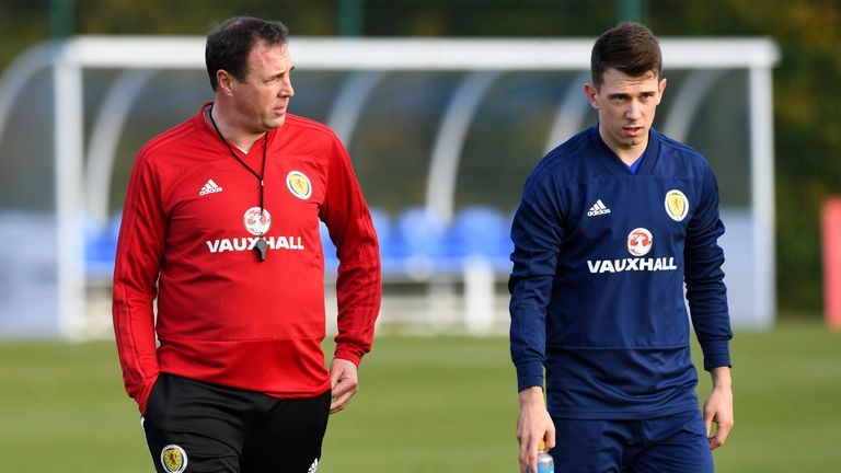 Malky Mackay (left) called a number of new faces into the Scotland squad including Rangers' Ryan Jack (right)
