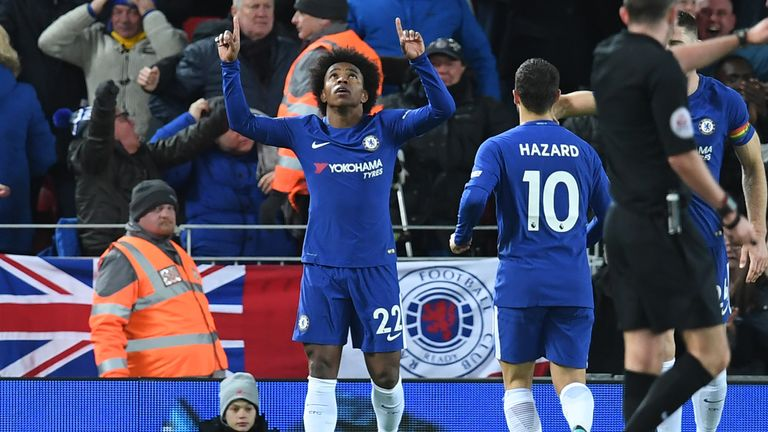 Willian (C) celebrates after scoring Chelsea's first goal during the English Premier League football match between Liverpool and Chelsea