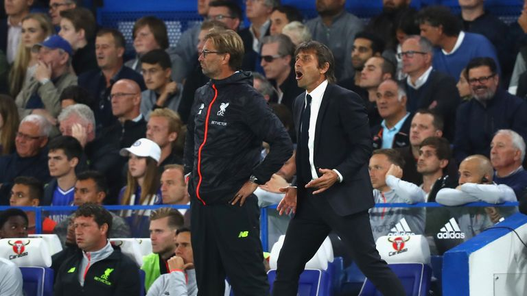 LONDON, ENGLAND - SEPTEMBER 16: Antonio Conte, Manager of Chelsea and Jurgen Klopp, Manager of Liverpool look on from the touchline during the Premier Leag