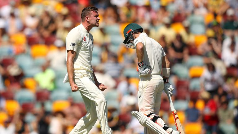 Jake Ball of England celebrates dismissing David Warner of Australia during day two of the First Test Match