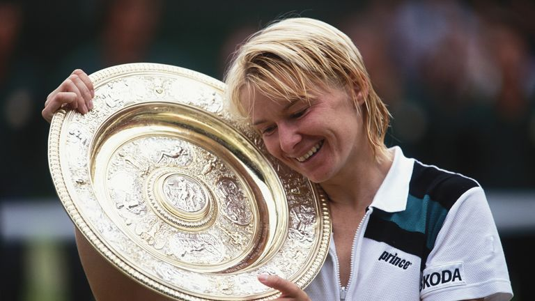 Jana Novotna holds her winners trophy during the 1998 Wimbledon Championships