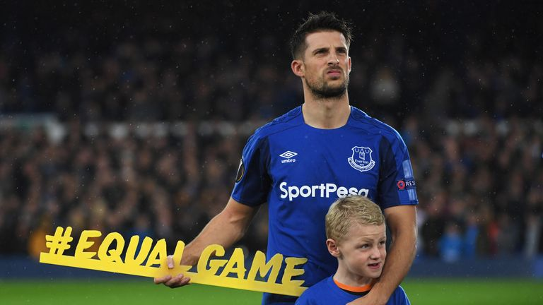 LIVERPOOL, ENGLAND - OCTOBER 19:  Kevin Mirallas of Everton holds the #equalgame banner prior to the UEFA Europa League Group E match between Everton FC an