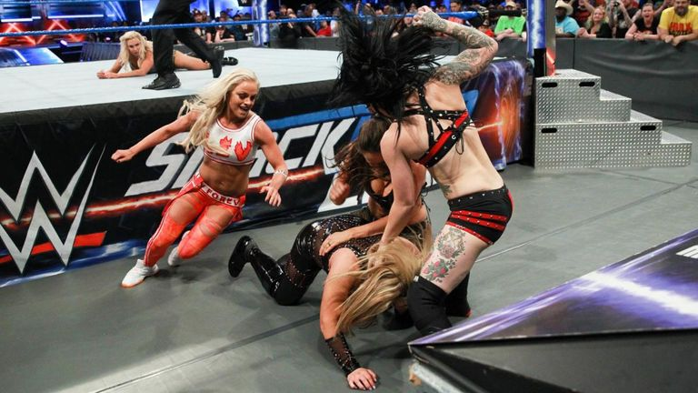 NXT trio Liv Morgan, Sarah Logan and Ruby Rose attacked Natalya and Charlotte during their title match