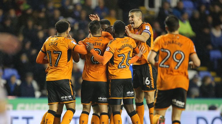 Conor Coady celebrates with Matt Doherty (obscured) as he celebrates scoring Wolves' second goal