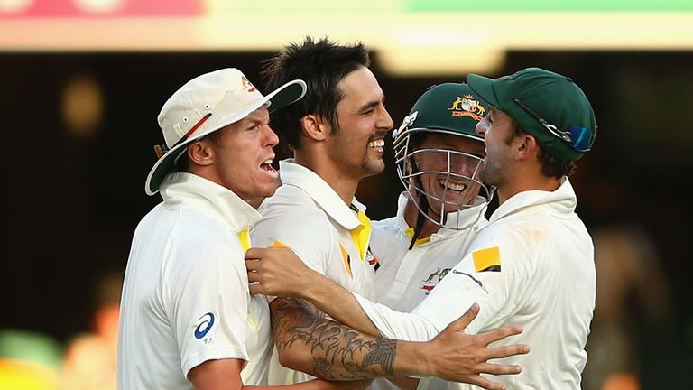 BRISBANE, AUSTRALIA - NOVEMBER 24:  Mitchell Johnson of Australia celebrates taking the wicket of James Anderson of England and winning the first test duri