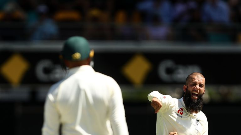Moeen Ali of England celebrates after taking the wicket of Usman Khawaja of Australia during day two of the First Test