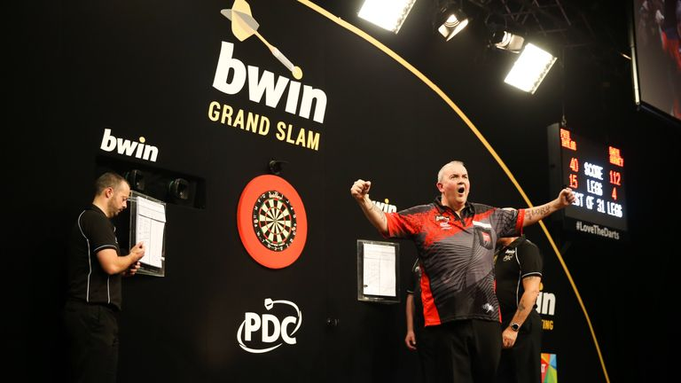 BWIN GRAND SLAM OF DARTS 2017 CIVIC HALL, WOLVERHAMPTON PIC;LAWRENCE LUSTIG QUATER FINALS PHIL TAYLOR V DARLY GURNEY PHIL TAYLOR wins