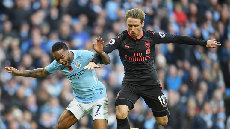 MANCHESTER, ENGLAND - NOVEMBER 05:  Nacho Monreal of Arsenal fouls Raheem Sterling of Manchester City and a penalty is awarded during the Premier League ma
