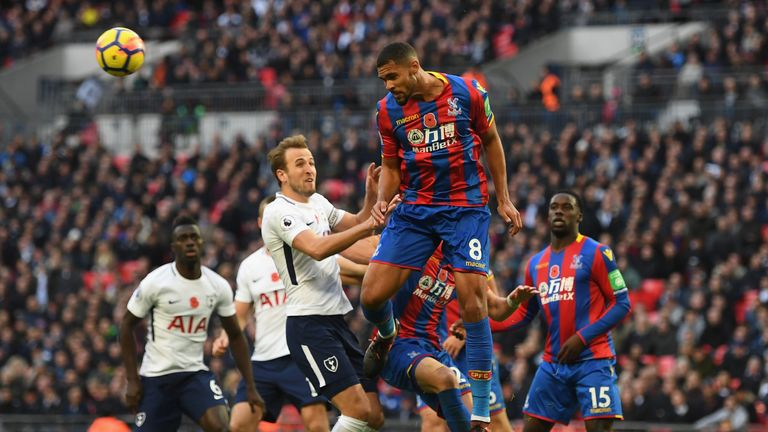 LONDON, ENGLAND - NOVEMBER 05:  Ruben Loftus-Cheek of Crystal Palace and  Harry Kane of Tottenham Hotspur battle for possession in the air during the Premi