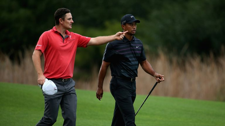 ANTALYA, TURKEY - NOVEMBER 07:  Justin Rose of England and Tiger Woods of the USA have a chat during the first round of the Turkish Airlines Open at The Mo