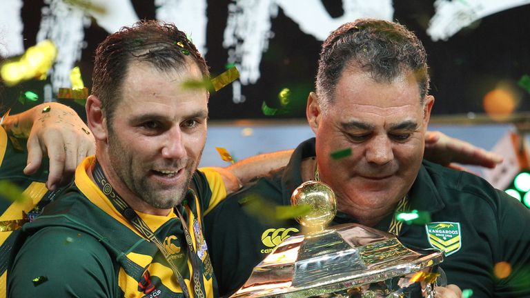 Australia's captain Cameron Smith (L) and coach Mal Maninga with the Rugby League World Cup trophy