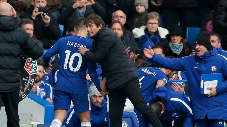 Antonio Conte salutes Eden Hazard as he leaves the field of play