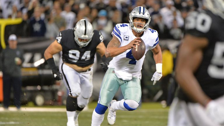 Cowboys edge Raiders, keep NFC playoff hopes alive