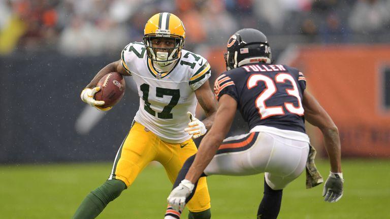 Fuller prepares to tackle Davante Adams of the Green Bay Packers