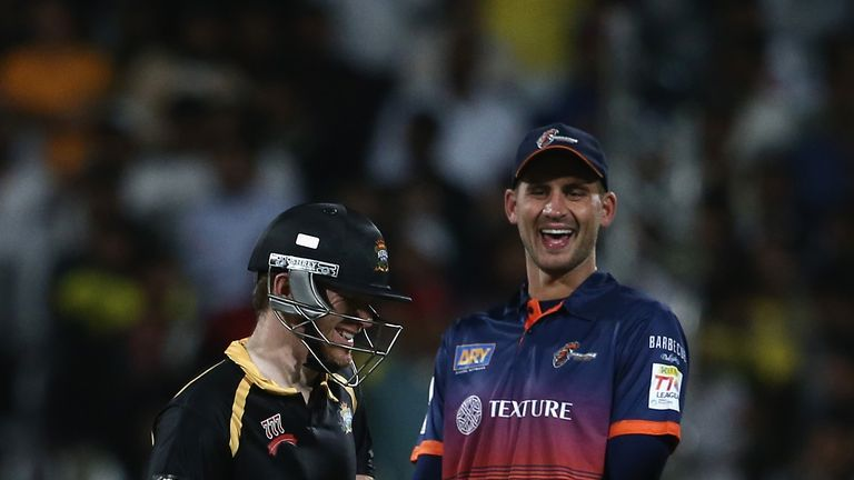 Eoin Morgan and Alex Hales share a joke during the T10 League in Sharjah