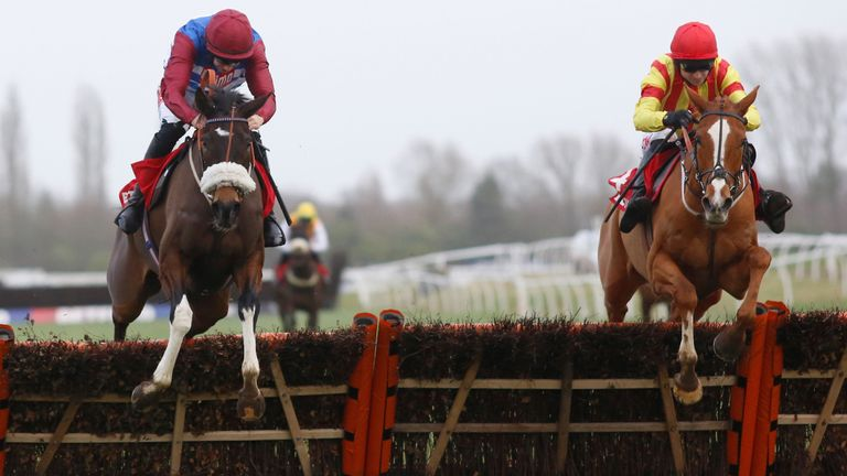 Poetic Rhythm and Paddy Brennan (right) clear the last flight before winning the Chalow Hurdle