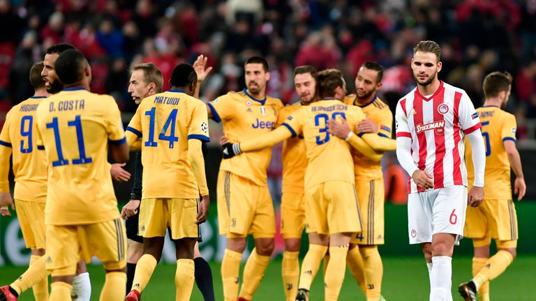 Juventus players celebrate after a 2-0 win over Olympiakos