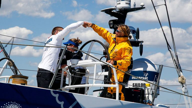 Turn the Tide on Plastic duo Lucas Chapman & Liz Wardley fist bump as they reach Melbourne (Jesus Renedo/Volvo Ocean Race)