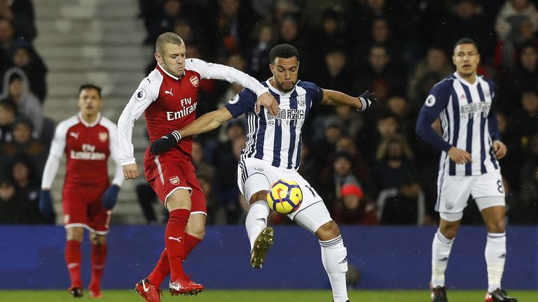 Matt Phillips and Jack Wilshere battle for the ball