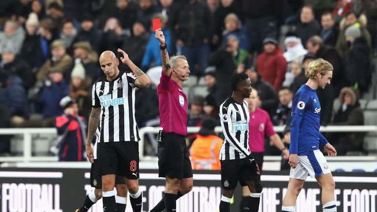 Jonjo Shelvey  is shown a red card by referee by Martin Atkinson late on