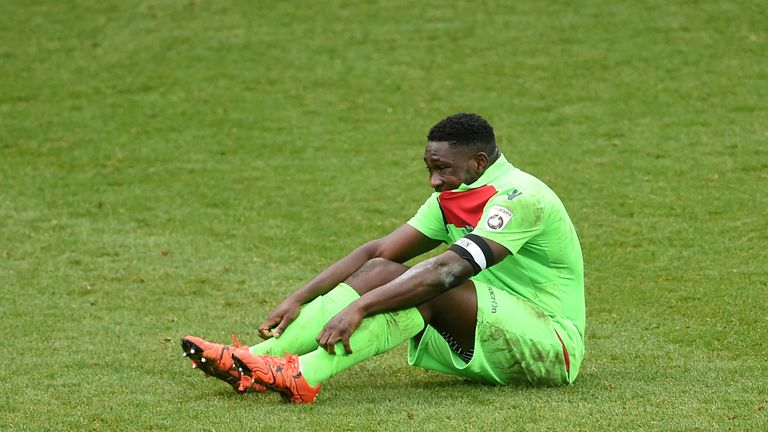 Oxford City's Godfrey Poku dejected after the match