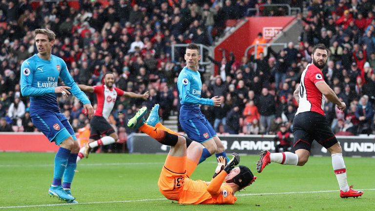 Nacho Monreal, Laurent Koscielny and Charlie Austin all look towards the linesman after Southampton's opener